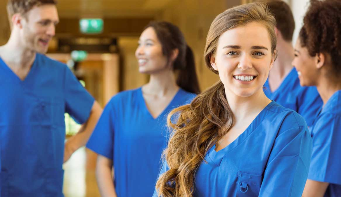 247 nursing & medical services, overseas nurse placements, nursing agency, young female nurse with colleagues in background